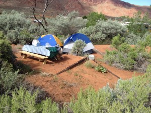 Tent sites include leveled pads for tents and picnic table. Here, two tents share a single site. Natural vegetation provides privacy.